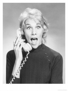 woman-on-telephone-looking-surprised-posters